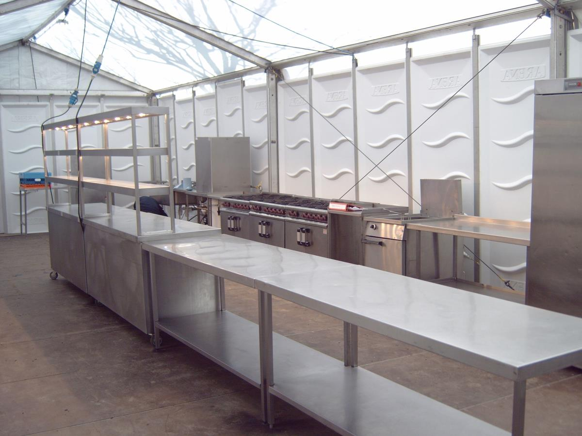 Spacious temporary marquee kitchen catering an a la carte restaurant at a horse racing event.